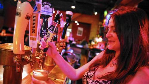 Bartender Sinead Talty pours a Coors Banquet from the tap at Mac's Wood Grilled in Chicago. (Chris Sweda / Chicago Tribune) By Greg Trotter Chicago Tribunecontact the reporter